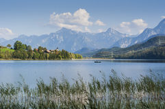 Bavarian landscape with lake and fisher boat Stock Image