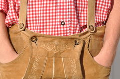 Bavarian leather trousers. Hands in pockerts of Bavarian style leather trousers   Lederhose Stock Photo