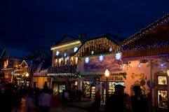 Bavarian Leavenworth Christmas Holiday Bustle. This scene is a Bavarian store lit up with Christmas lights at night with shoppers.  Taken at Leavenworth Stock Photos