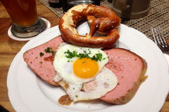 Bavarian Lunch. A lunch of Bavarian meatloaf with fried egg and a pretzel Royalty Free Stock Images