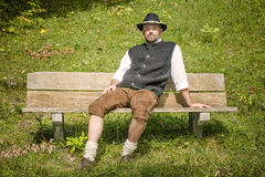 Bavarian man on bench Royalty Free Stock Photography