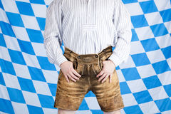 Bavarian man with brown Oktoberfest leather pants Royalty Free Stock Images