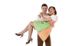 Bavarian man carries woman with dirndl  on hands Royalty Free Stock Photos