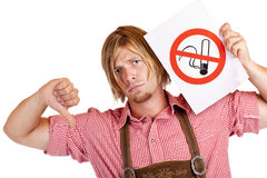 Bavarian man disagrees to non-smoking-rule Royalty Free Stock Photography
