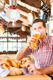 Bavarian man drinking wheat beer Royalty Free Stock Image
