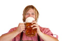 Bavarian man drinks out of oktoberfest beer stein Stock Photos