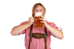 Bavarian man drinks out of oktoberfest beer stein Royalty Free Stock Photography