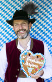 Bavarian man with gingerbread heart Royalty Free Stock Images