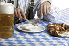 Bavarian man having lunch at Oktoberfest Royalty Free Stock Photography