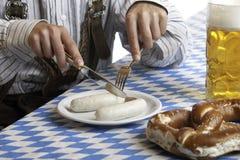 Bavarian Man having Oktoberfest meal Stock Photo