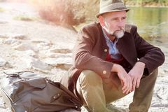 Bavarian man in his 50s sitting by the river. Portrait of bavarian man in his 50s sitting by the river royalty free stock image