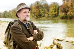 Bavarian man in his 50s standing by the river. Portrait of bavarian man in his 50s standing by the river stock photos