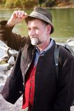 Bavarian man in his 50s standing by the river Stock Images