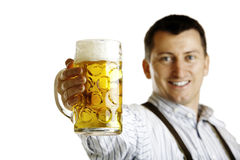 Bavarian man hold beer stein at Oktoberfest Stock Images