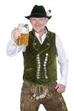 Bavarian man holding a mug of beer Royalty Free Stock Image