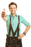 Bavarian man holds his thumbs up Royalty Free Stock Photography