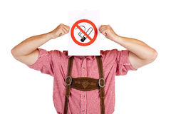 Bavarian man holds no-smoking-rule sign Stock Photography
