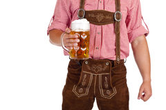 Bavarian man holds Oktoberfest beer stein Royalty Free Stock Images