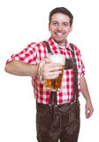 Bavarian man with leather pants showing beer mug Royalty Free Stock Images