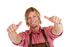 Bavarian man with Lederhose shows both thumbs up Royalty Free Stock Photo