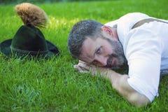 Bavarian man lying on the grass Stock Photos