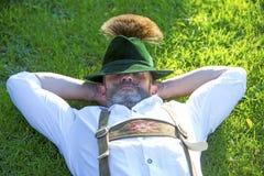 Bavarian man sleeping on the grass Royalty Free Stock Image