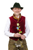 Bavarian man in traditional clothes holding a plastic flower Stock Photos