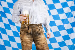 Free Bavarian Man With Leather Pants Holds Beer Stein Royalty Free Stock Photography - 15268967