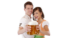 Bavarian man and woman with oktoberfest beer stein Royalty Free Stock Images