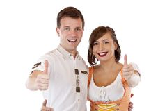 Bavarian man and woman showing thumbs up Stock Image