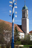 Bavarian Maypole with church Royalty Free Stock Photo