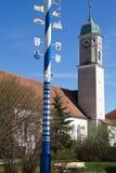 Bavarian Maypole with church Royalty Free Stock Photo