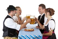 Bavarian men and women drink Oktoberfest beer Royalty Free Stock Photo