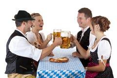 Bavarian men and women drink Oktoberfest beer Royalty Free Stock Photo