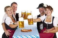 Bavarian men and women drink Oktoberfest beer Stock Photos