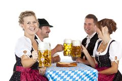 Bavarian men and women toast with Oktoberfest beer Stock Photo