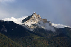 Bavarian mountain Wendelstein with fog in autumn Stock Image