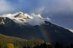Bavarian mountain Wendelstein with fog and rainbow Royalty Free Stock Image
