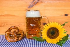 Oktoberfest beer and pretzels on table with bavarian blue white pattern royalty free stock images
