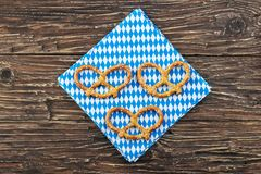 Bavarian oktoberfest  pretzel. Beer snacks on wooden table. Bavarian oktoberfest  pretzel. Beer snacks on a wooden table Royalty Free Stock Images