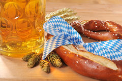 Bavarian Oktoberfest soft pretzel with beer Stock Photos