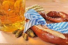 Bavarian Oktoberfest soft pretzel with beer Stock Photos