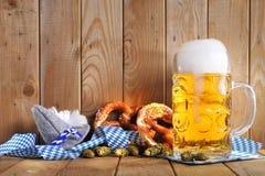 Bavarian Oktoberfest soft pretzel with beer Stock Photography