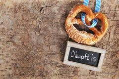 Bavarian Oktoberfest soft pretzel with blackboard Stock Photos
