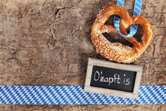 Bavarian Oktoberfest soft pretzel with blackboard Royalty Free Stock Image
