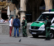Bavarian police in central Munich. German police checks on young skins square in Munich Royalty Free Stock Photography