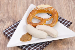 Bavarian pretezel with sausage Stock Images