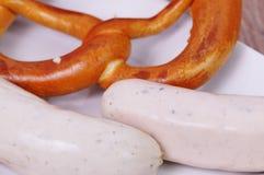 Bavarian pretezel with sausage Stock Photo
