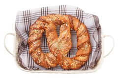Bavarian pretzel lying in a basket on a white background.  stock photos