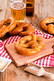 Bavarian pretzels. Bavarian pretzels with beer on wooden table Stock Photography